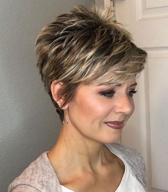 cute short haircuts for girls, brown hair, blonde highlights, grey cardigan, white top