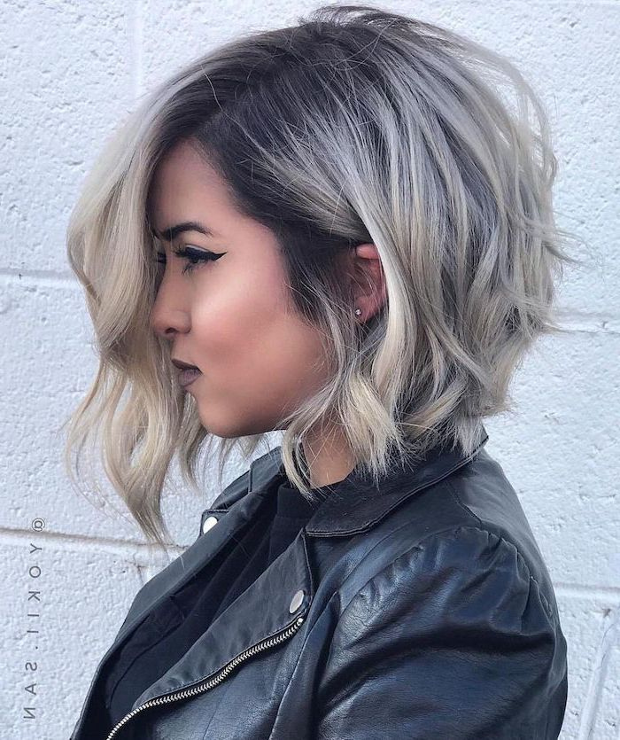 platinum blonde hair, black leather jacket, cute short haircuts for girls, white brick wall