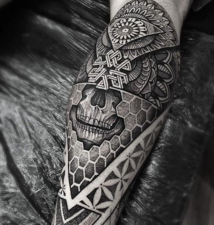 black background, skull leg tattoo, mandala thigh tattoo