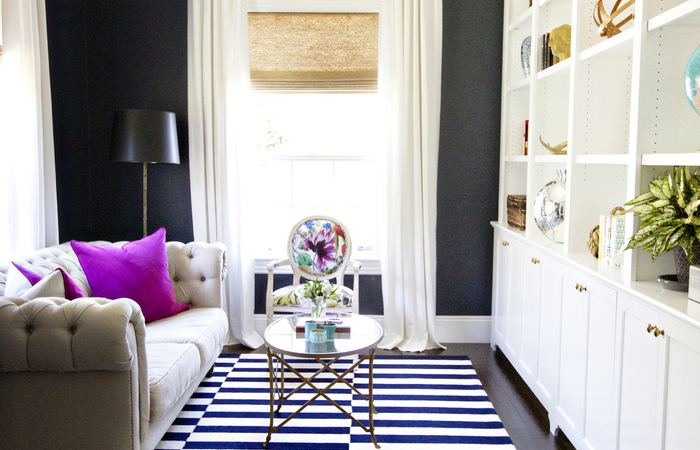 white sofa, pink throw pillows, black accent wall, white bookshelf, couches for small living rooms, wooden floor