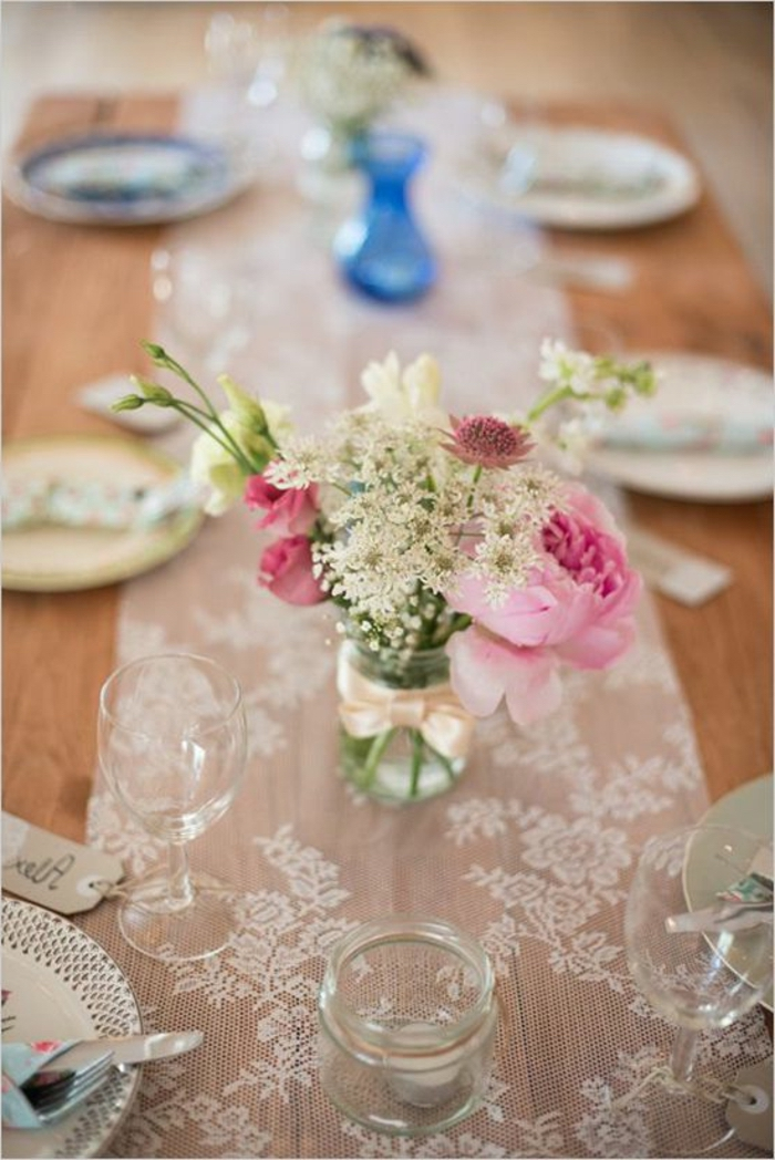 simple centerpieces, small glass jar, spring flower bouquet, white lace, table runner, table settings