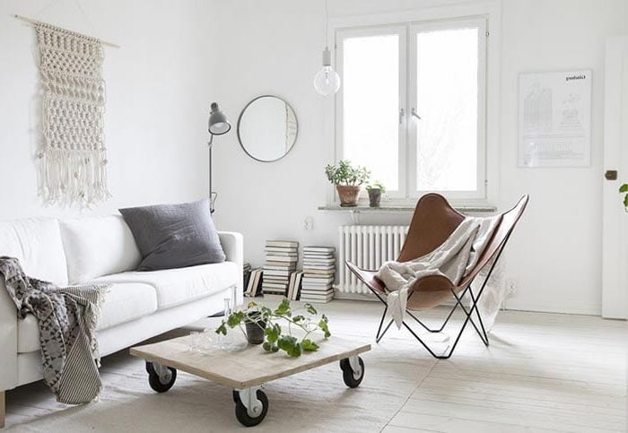 white sofa, small wooden coffee table, on wheels, brown leather chair, small apartment living room ideas