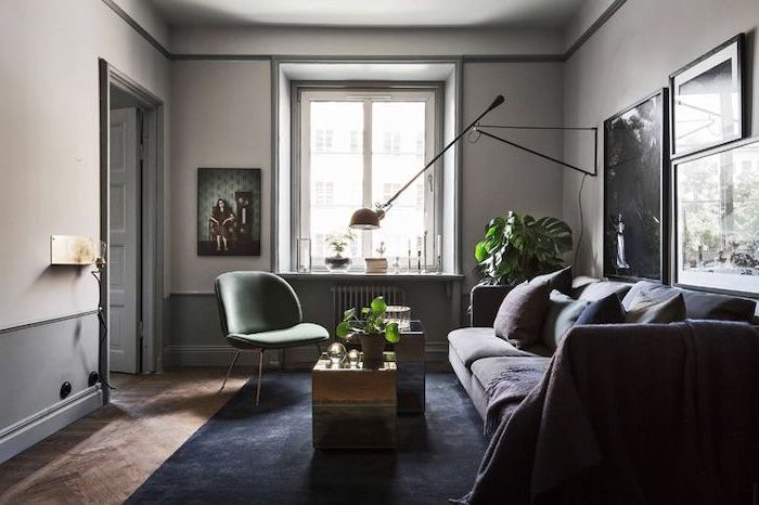 small apartment living room ideas, dark blue velvet carpet, grey sofa, green chair, metal coffee tables