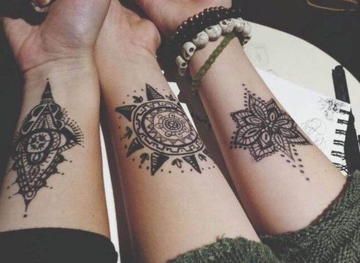 matching forearm tattoos, green blouse, mandala thigh tattoo
