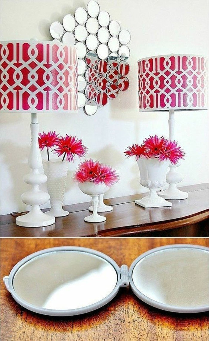 small round mirrors, arranged together, hanging on a white wall, girls wall decor, red lamp shades