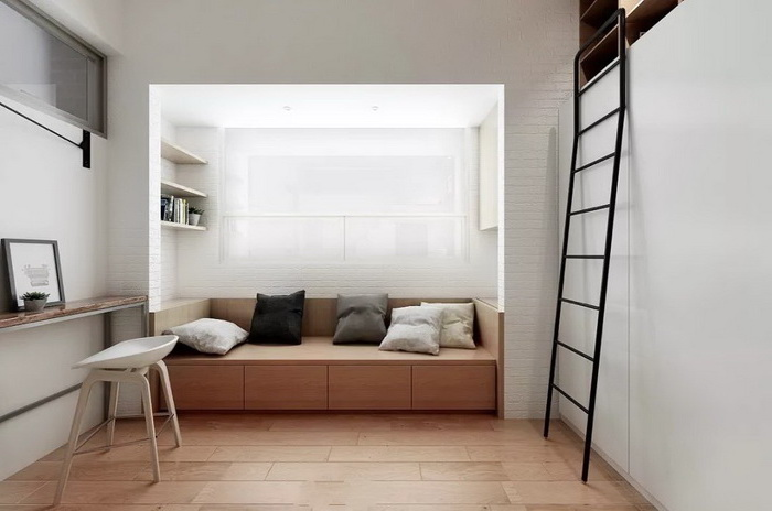 black metal ladder, wooden couch, throw pillows, white chair, small apartment living room ideas, wooden floor