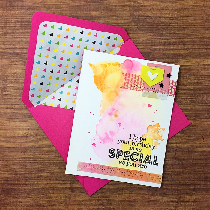 pink envelope, colourful hearts on it, watercolour greeting card, homemade cards, wooden table
