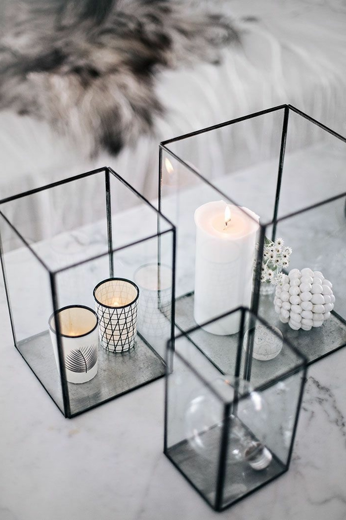 square glass aquariums, full of candles, on a marble countertop, simple centerpieces