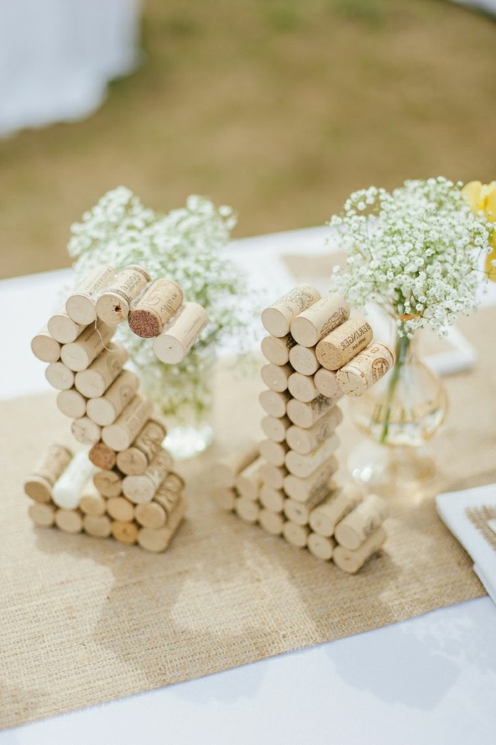 table numbers, made out of cork screws, simple centerpieces, baby's breath, small bouquets