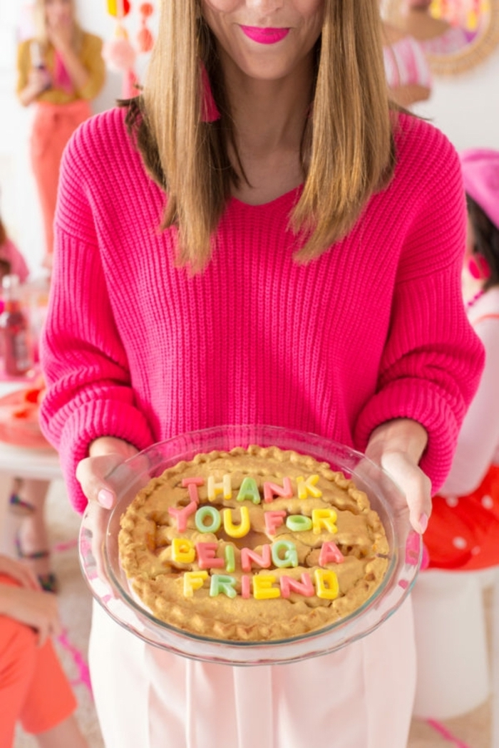 pink sweater, thank you for being a friend pie, diy christmas gifts for mom, woman holding a pie