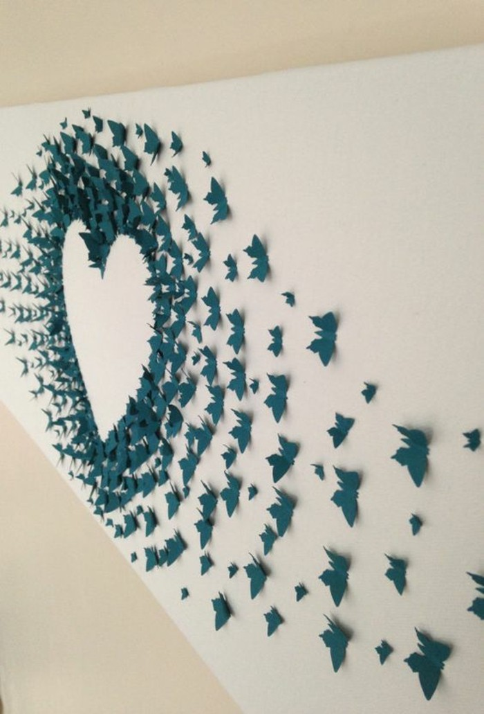 turquoise paper butterflies, outlining a heart, glued to a white wall, how to decorate a wall