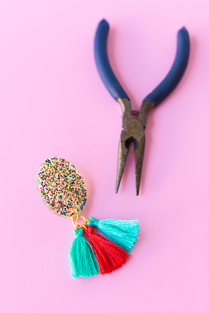 blue pliers, colourful tassel earrings, colourful glitter, birthday gift ideas, pink background