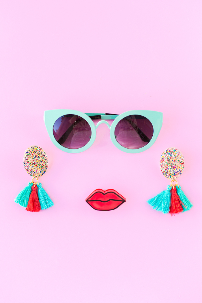 turquoise sunglasses, red lips, colourful tassels, colourful glitter, creative gift ideas, pink background