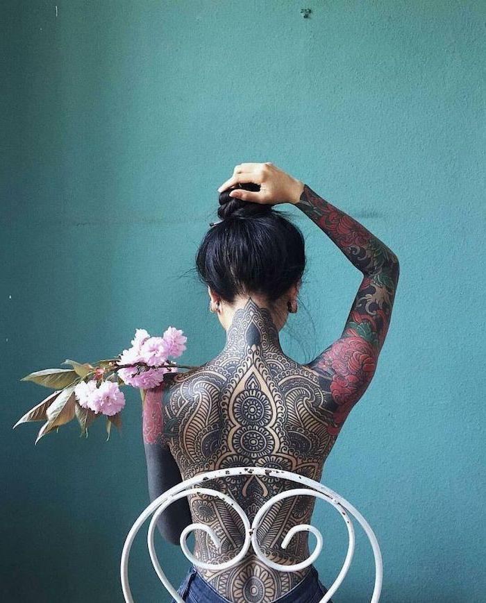 blue background, white metal chair, mandala tattoo, whole back tattoo, sleeve tattoos