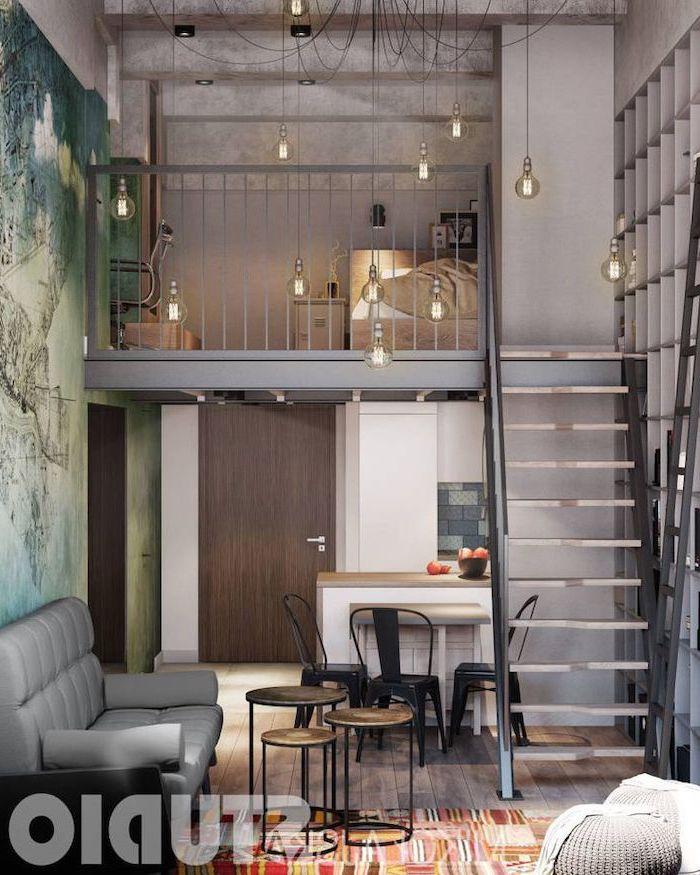 small living room furniture arrangement, two level studio apartment, photo wallpaper, accent wall, metal railing