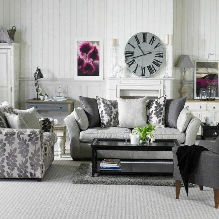 grey couch living room, metal black coffee table, vintage clock, above the fireplace, grey carpet