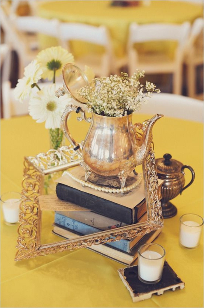 vintage teapot, spring flower arrangements, on top of books, golden frame, glass candle holders