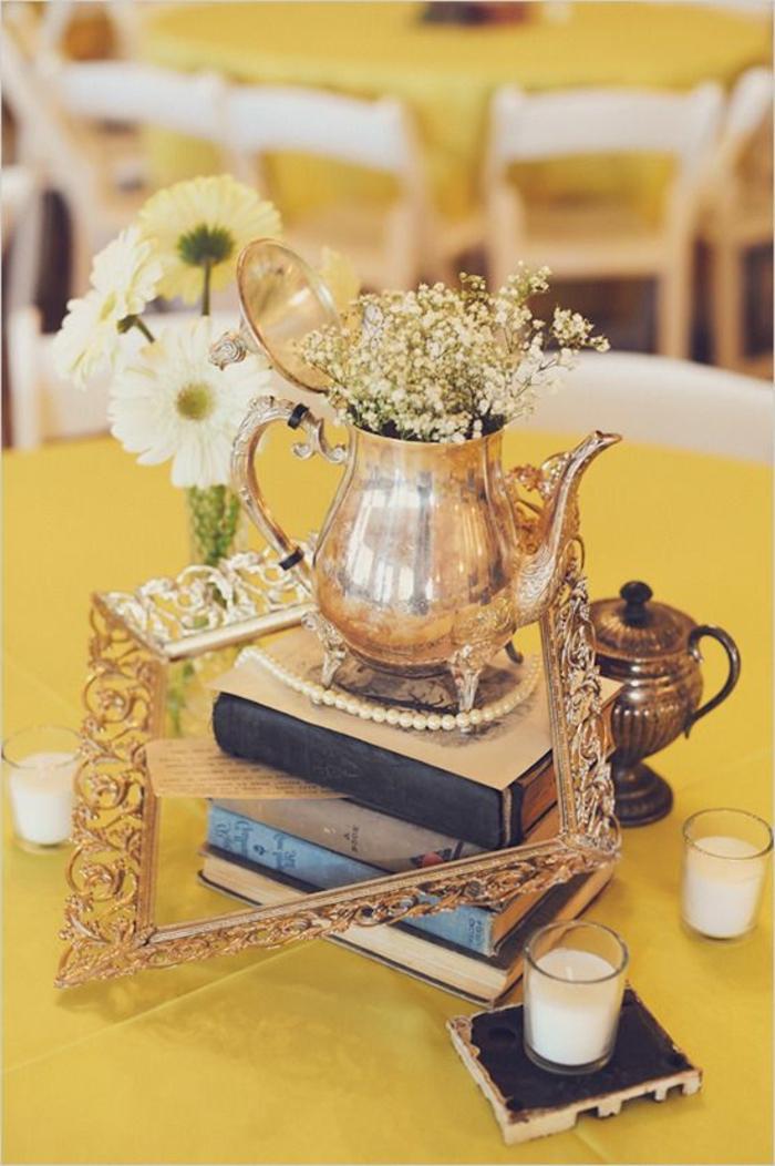 vintage teapot, spring flower arrangements, on top of books, golden frame, glass candle holders