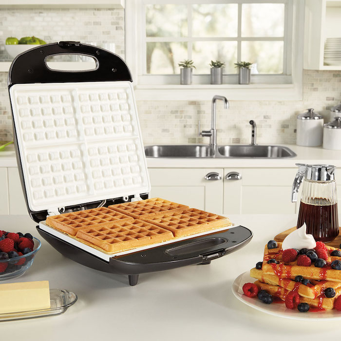 house warming present, waffle maker, maple syrup, strawberries and blueberries