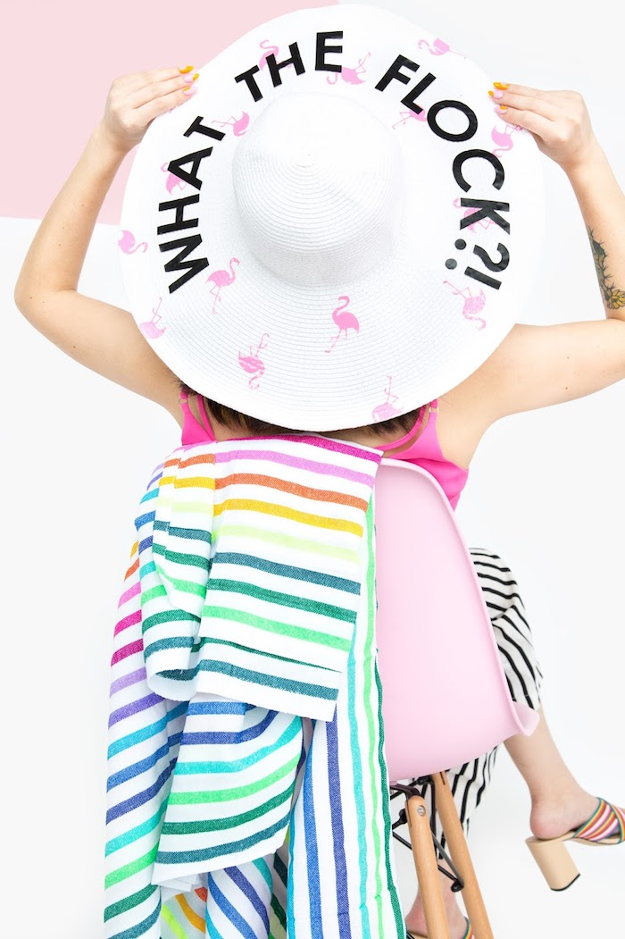 what the flock, large white hat, pink flamingos, unique gifts for boyfriend, woman sitting, on a pink chair