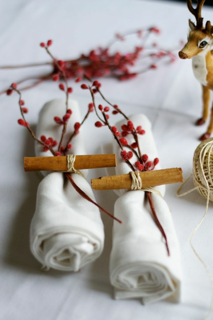folded white cotton napkins, tied with paper and a tree branch, spring flower arrangements