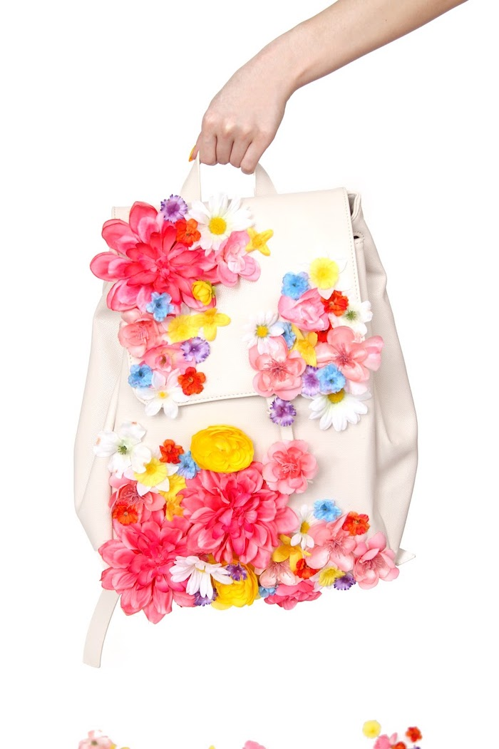 colourful faux flowers, glued to a white leather backpack, homemade christmas gifts