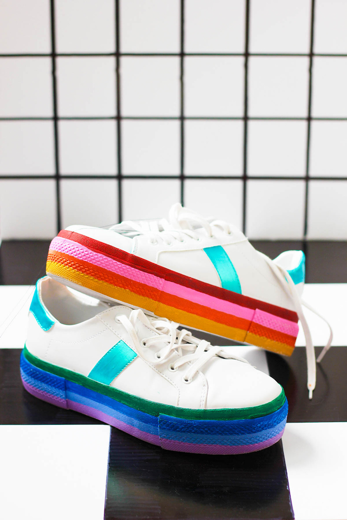 thoughtful gifts, white sneakers, rainbow coloured soles, white and black, tiled background