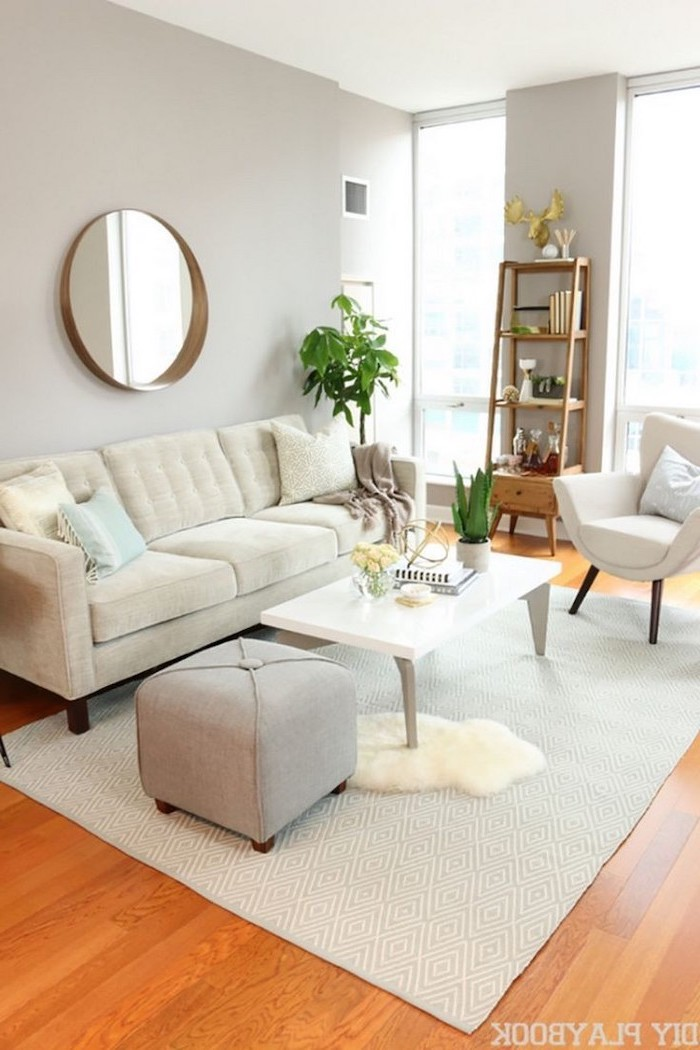 white sofa, grey ottoman, small living room furniture arrangement, white metal coffee table, white armchair