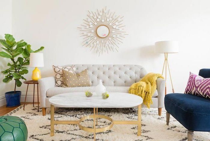 white sofa, brass metal coffee table, marble countertop, how to arrange furniture, blue velvet armchair