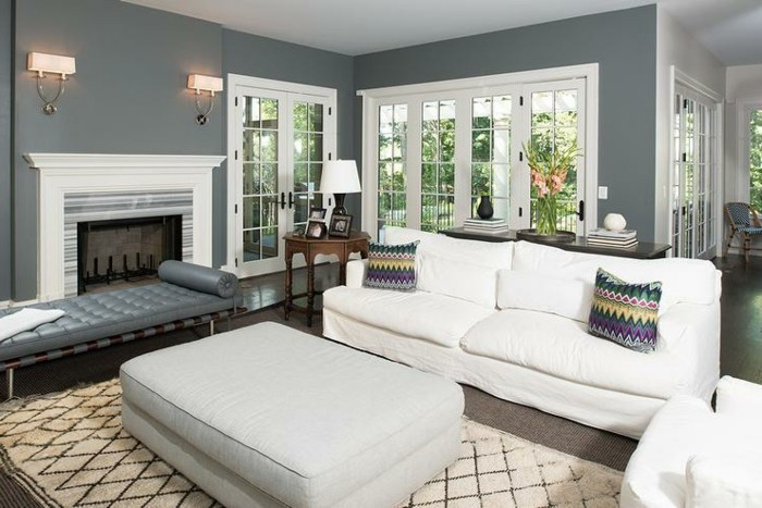 white sofa and armchair, light grey ottoman, printed colourful, throw pillows, grey living room furniture