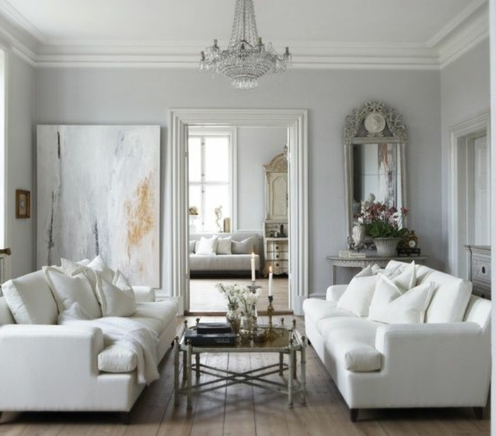white sofas, metal coffee table, abstract art, grey living room furniture, wooden floor