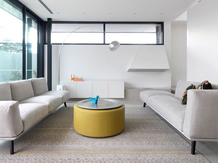 white sofas, yellow ottoman, metal tray, printed carpet, how to arrange furniture, white cabinets