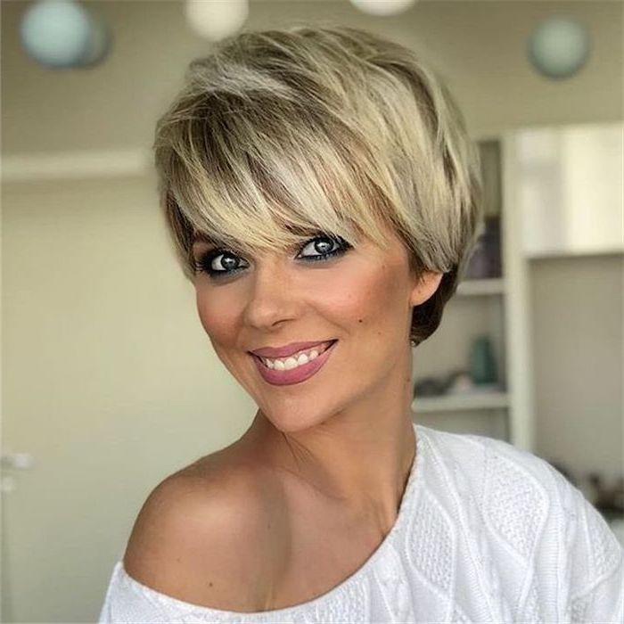 white sweater, blonde hair, short wavy hairstyles, white background