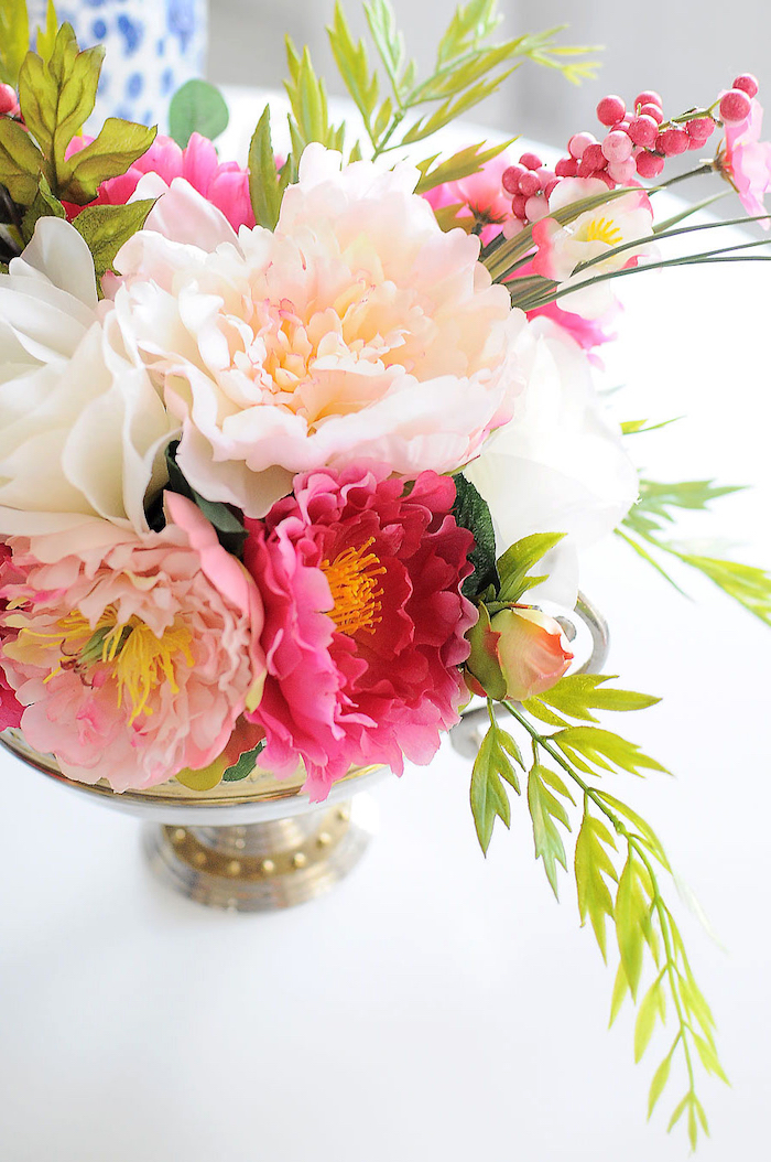 ppink adn white, flower bouquet, table centerpieces, inside a metal bowl, on a white table