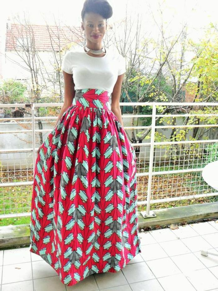 white shirt, long skirt, black hair, in a bun, african print maxi dresses, tiled floor, metal railing