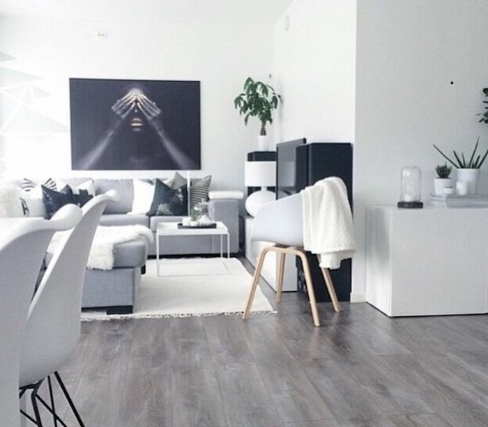 nice living rooms, grey corner sofa, printed throw pillows, wooden floor, white metal coffee table