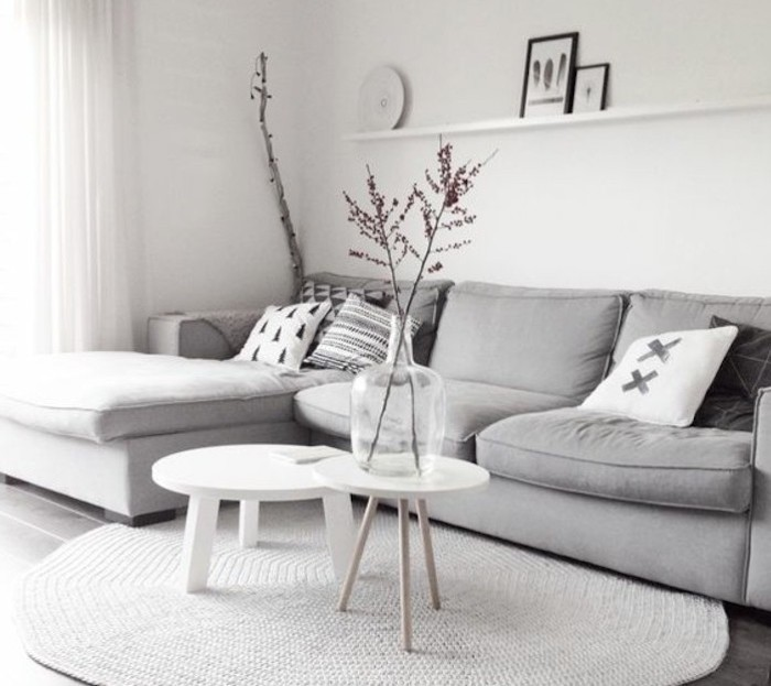 grey corner sofa, white walls, white wooden coffee tables, gray and white living room
