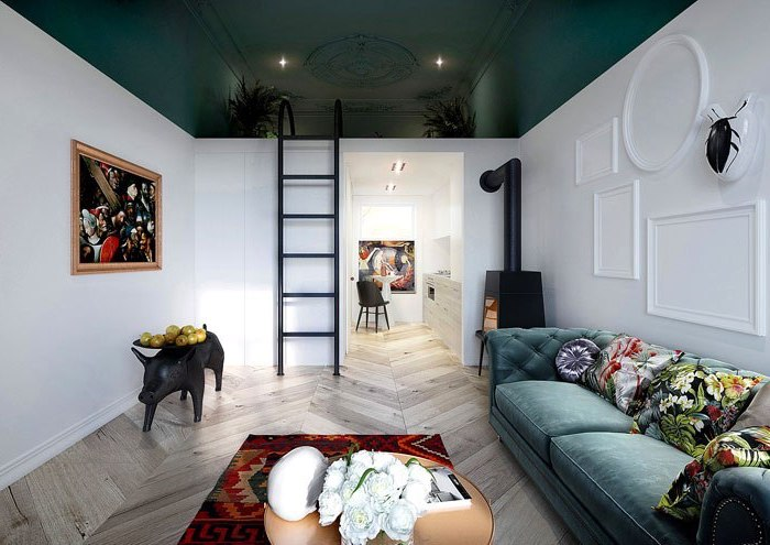blue velvet sofa, half white, half blue walls, black metal ladder, wooden floor, how to decorate a living room