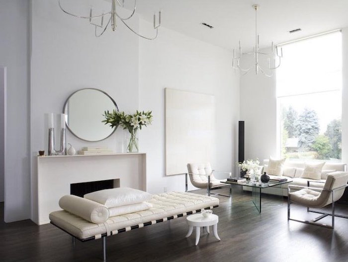 living room dining room combo, white sofa, white armchairs, wooden floor, white walls, glass coffee table