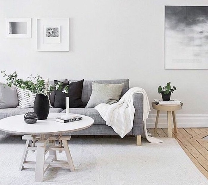white carpet, hanging framed art, grey sofa, grey and black, throw pillows, wooden coffee table, nice living rooms