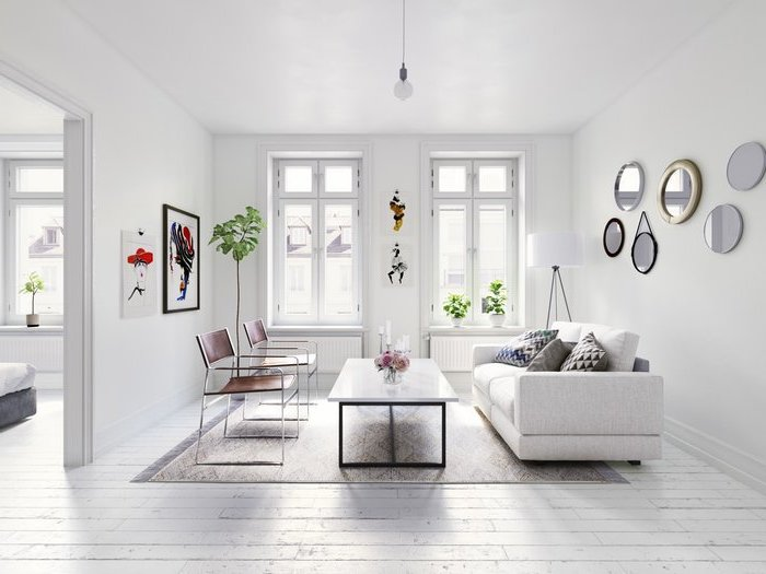 white walls, living room dining room combo, white sofa, brown leather chairs, metal coffee table