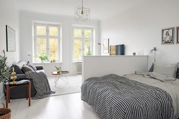grey sofa, wooden floor, small wooden and metal, coffee tables, living room dining room combo, white walls