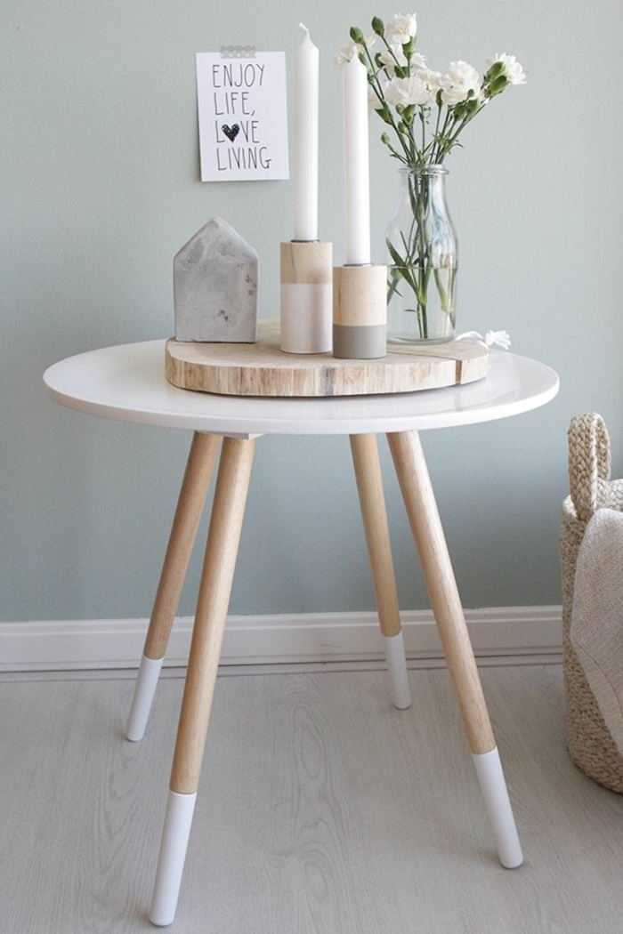 small round side table, wooden board, candles on top, spring flower arrangements, white flower bouquet