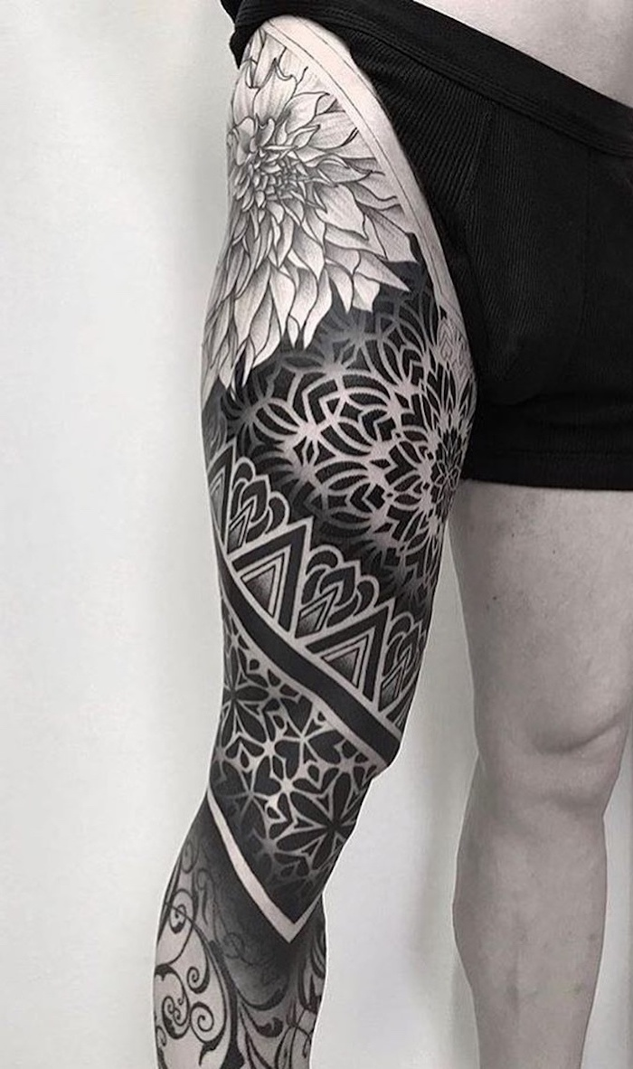 black boxers, white background, whole leg tattoo, small mandala tattoo