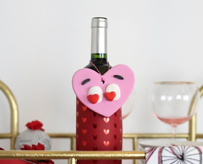 diy gifts for friends, wine bottle, red sleeve with hearts, large pink heart, with heart shaped eyes
