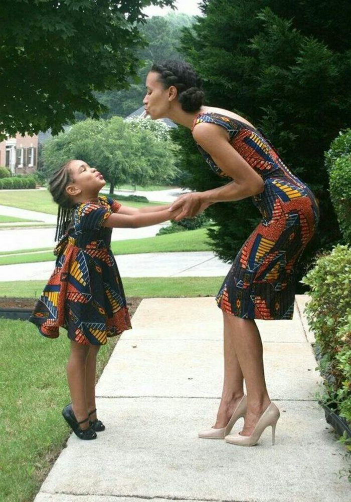 african print maxi dresses, woman and a girl, holding hands and kissing, short dresses, braided hair