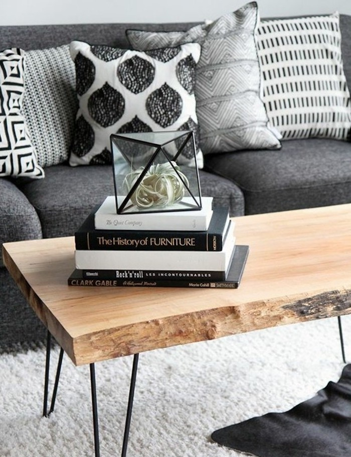 wooden coffee table, set of books, grey sofa, printed throw pillows, nice living rooms, white carpet
