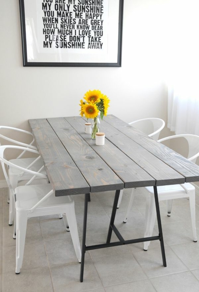 wooden grey table, metal white chairs, table arrangements, small sunflower bouquet, framed inspirational quote