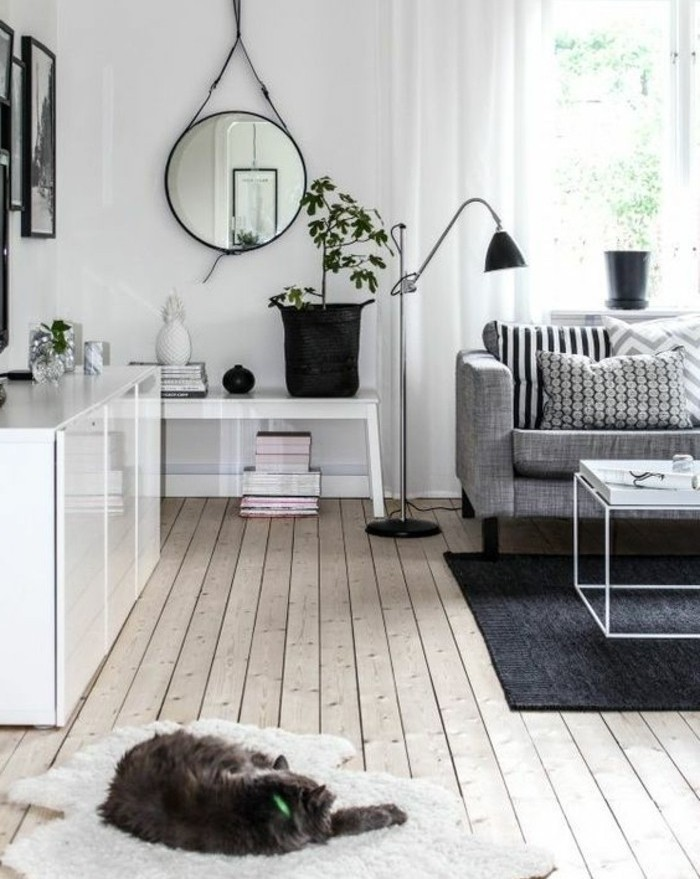 cat sleeping on a white rug, nice living rooms, grey sofa, white metal coffee table, wooden floor