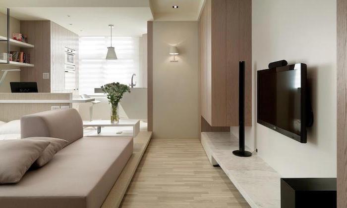 beige sofa, wooden floor, living room dining room combo, wooden cabinets, marble countertop